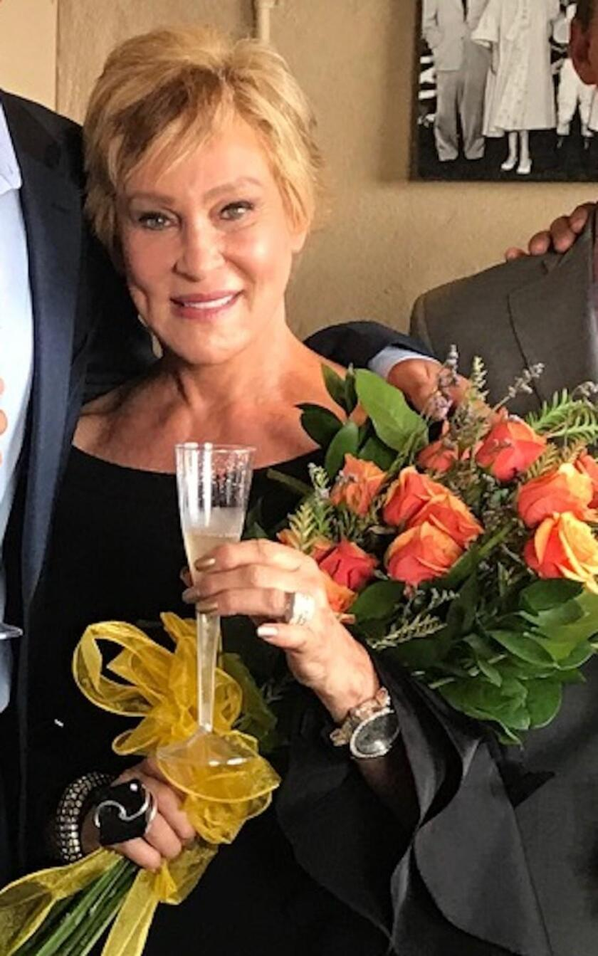 Sherry Ahern in the Winners Circle Box last year after the Aherns' horse, Unobtainable, won at Del Mar. For founding La Jolla's Open Aire Market and Art & Wine Festival, she calls herself the 'Head of Lettuce' and 'Queen of Arts.'