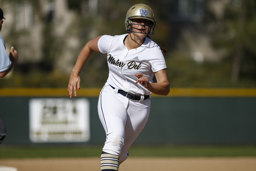 Mater Dei softball first baseman Lexi Sosa (18) advances to third base before scoring on a double by Annalisa Soto in the first inning against Grossmont on Friday, March 15th, 2019.