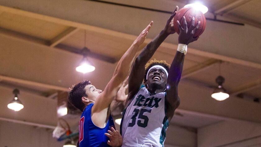 Helix forward Jaylen Arnold drives to the basket in the SoCal Regional finals against Reedley Immanuel.