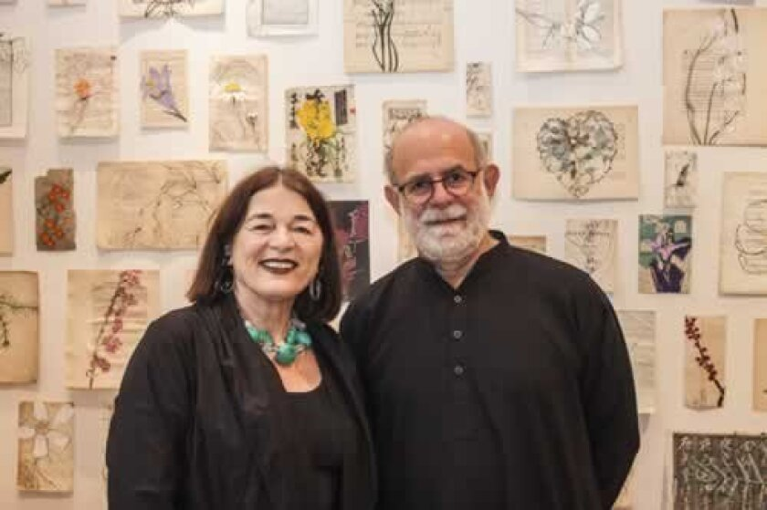 Athenaeum Executive Director Erika Torri and artist Robert Kushner in front of his exhibit, 'Robert Kushner's Scriptorium: Devout Exercises of the Heart.' Maurice Hewitt