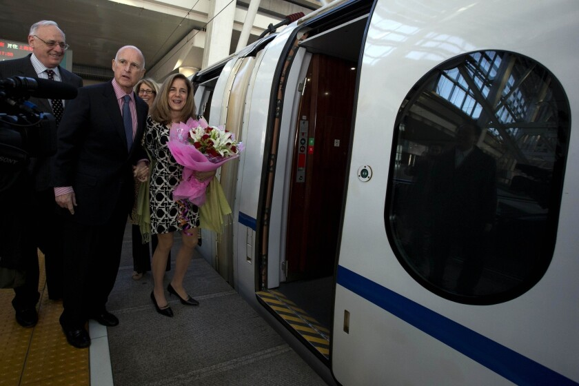 California Gov. Jerry Brown and his wife, Anne Brown, with Dan Richard, chairman of the California High Speed Rail Authority, left, prepare to board a high-speed train in Beijing. The governor has been a major supporter of high-speed rail in California.