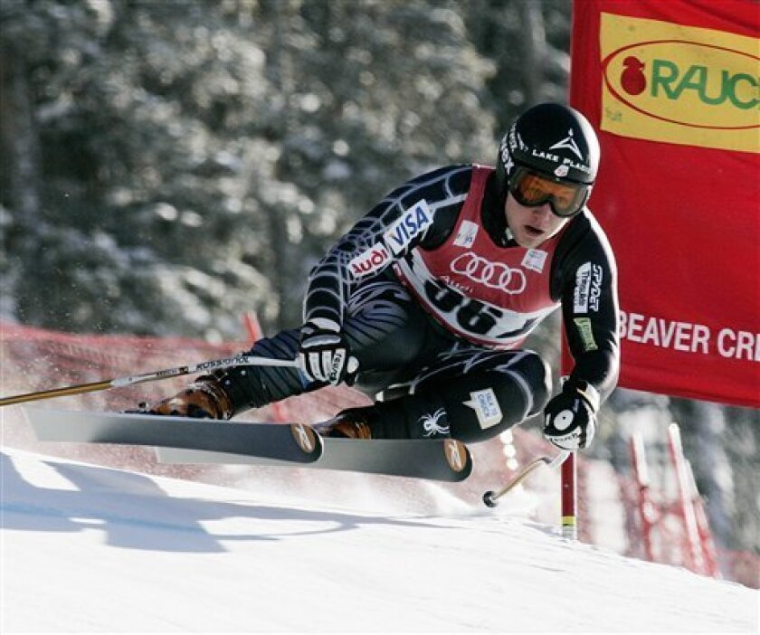 """U.S. skier Andrew Weibrecht races past a gate during a training run for the men's World Cup downhill ski race on Thursday, Dec. 3, 2009, in Beaver Creek, Colo. Weibrecht, a 23-year-old from Lake Placid, N.Y., kicked off his season last weekend at Lake Louise, finishing 12th in both the super-G and the downhill. These days, the skier nicknamed """"War Horse"""" wants to prove he's more than a one-trick pony. (AP Photo/ Nathan Bilow)"""