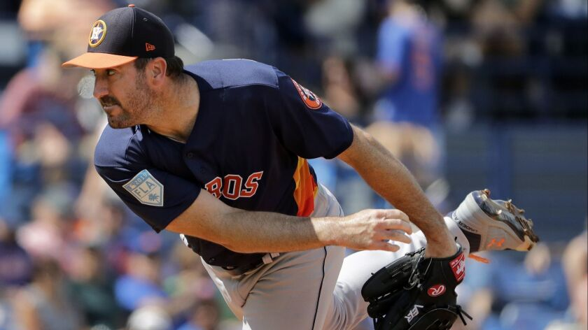 Houston Astros starting pitcher Justin Verlander throws during the first inning of an exhibition spr