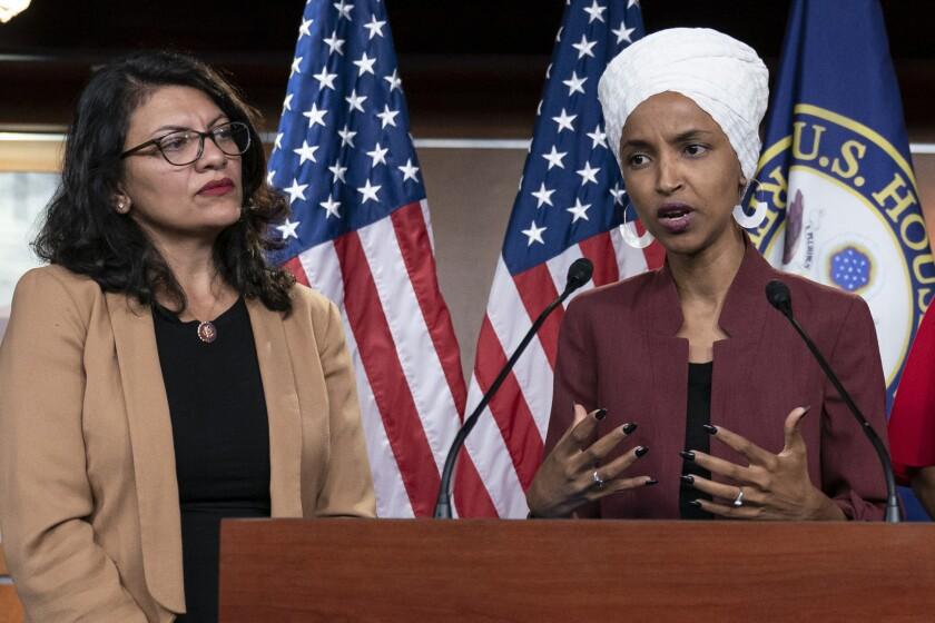 U.S. Reps. Rashida Tlaib (D-Mich.), left, and Ilhan Omar (D-Minn.)
