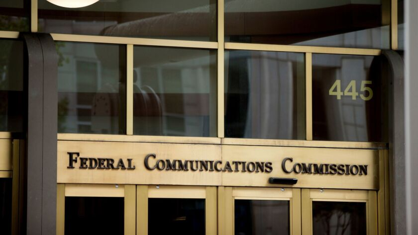 FILE - This June 19, 2015, file photo, shows the Federal Communications Commission building in Washi