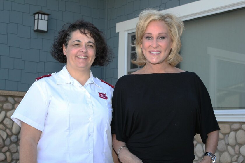 """Jessyca Carr, social services coordinator for Salvation Army of San Diego, and La Jollan Sherry Ahern, fundraising chair for Salvation Army Women's Auxiliary's April 7 'Women of Dedication' luncheon. Carr referred to Ahern as """"our cheerleader,"""" who encourages others to donate and volunteer with the"""