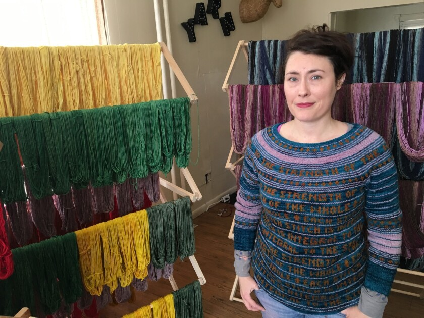 In this Jan. 25, 2017 file photo, Jill Draper is shown in her Kingston, N.Y., yarn studio. Draper raised money to pay off school lunch debts in her local district after seeing a tweet suggesting it would be a nice thing to do. Similar donation efforts around the country, inspired by the same tweet, have cleared thousands of dollars in overdue lunch fees.