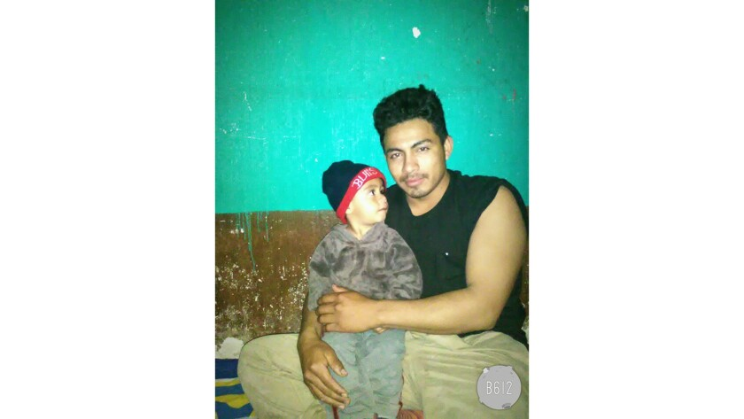 Andriy Ovalle Calderon, 2, with his father, Kristian Francisco Ovalle Hernandez in Guatemala. Four m
