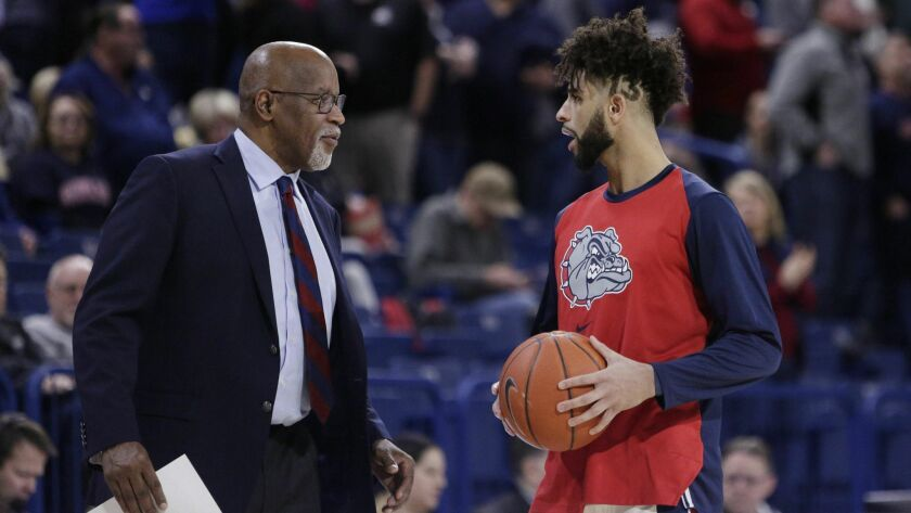 Gonzaga assistant coach Donny Daniels, left, speaks with guard Josh Perkins during halftime in an NC