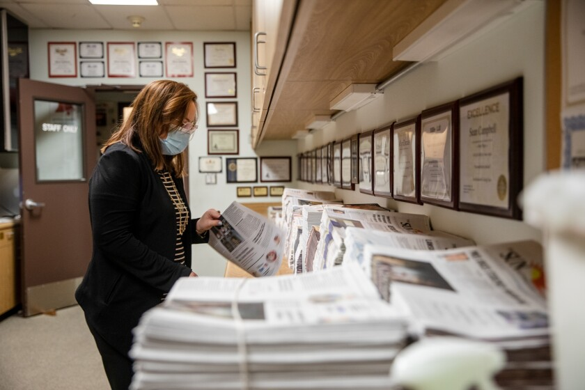Julia Woock, editor-in-chief of The Southwestern College Sun, gathers newspapers in the archive of the newsroom last week.