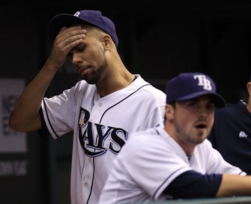 Tampa Bay Rays pitcher David Price, left, reacts as pitcher Brandon Gomes is unable to strike a Texas Rangers player during the seventh inning of Game 3 of baseball's American League division series, Monday, Oct. 3, 2011, in St.Petersburg, Fla. (AP Photo/Chris O'Meara)