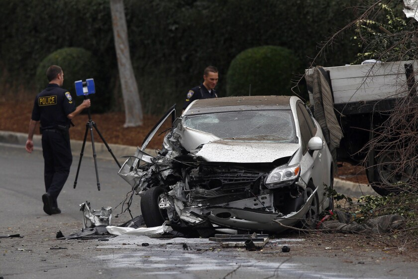 An investigation is underway after a truck crashed into a parked car in Beverly Hills Friday, on the same stretch of a steep roadway where two LAPD officers were killed in separate accidents involving trucks.