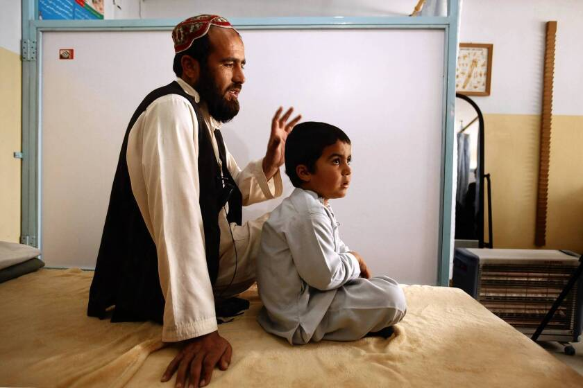 Amid Afghanistan war, U.S. aid is there for an injured child