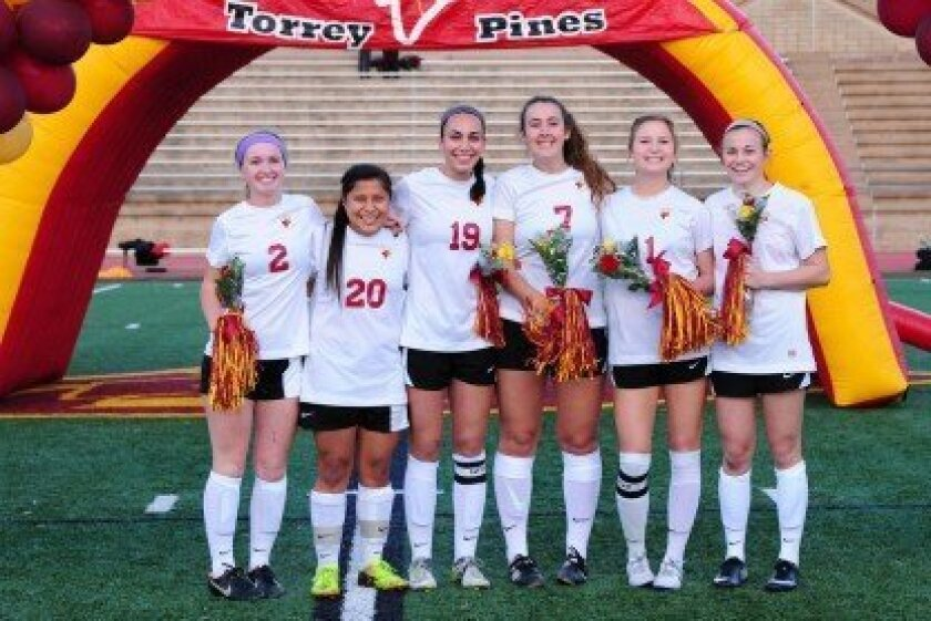 : Torrey Pines soccer celebrated graduating seniors Zoe Purcell, Stephanie Merida, Camelia Tirandazi, Gianna Giacalone, Courtney Coate and Macy Vrabel. Photo/Anna Scipione