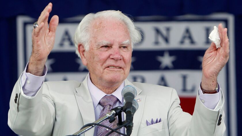 San Diego State alum Doug Harvey gestures after his Baseball Hall of Fame induction speech in Cooperstown, N.Y., in July 2010. Harvey died Jan. 13 in Visalia at age 87.