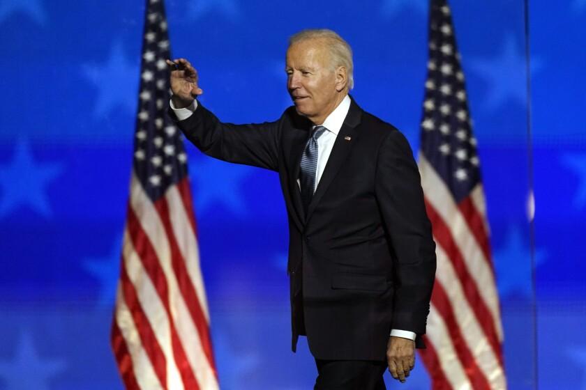 Joe Biden waves to supporters in Wilmington, Del.