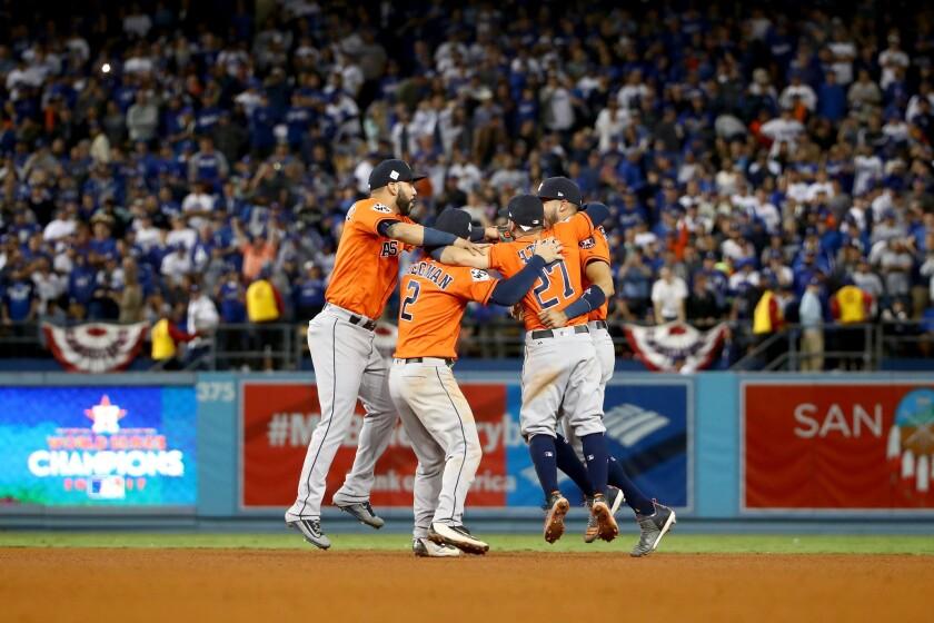 Astros Marwin Gonzalez, Alex Bregman, Jose Altuve and Carlos Correa celebrate their game seven World Series win over the Dodgers at Dodger Stadium on Nov. 1, 2017.