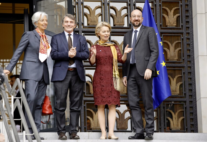 From left, European Central Bank President Christine Lagarde, European Parliament President Sassoli, European Commission President Ursula von der Leyen, and European Council President Charles Michel pose for photographers as they mark the 10th anniversary of the entry into force of the Lisbon Treaty at the House of European History in Brussels, Sunday, Dec. 1, 2019. (AP Photo/Olivier Matthys)