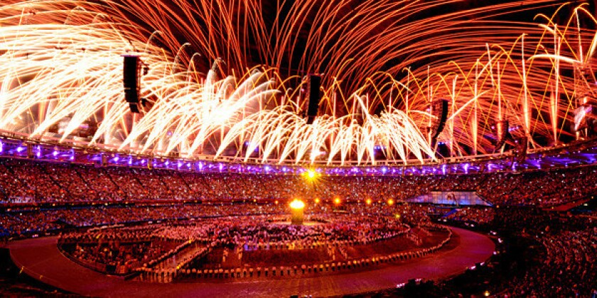 Fireworks cover the Olympic Stadium during Opening Ceremonies.