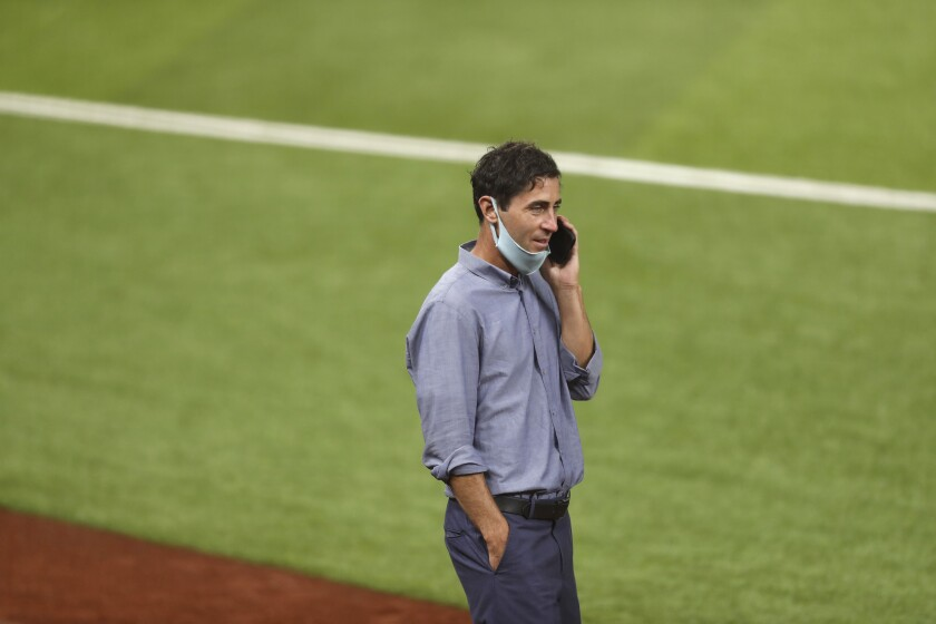 General Manager A.J. Preller of the San Diego Padres talks on the phone