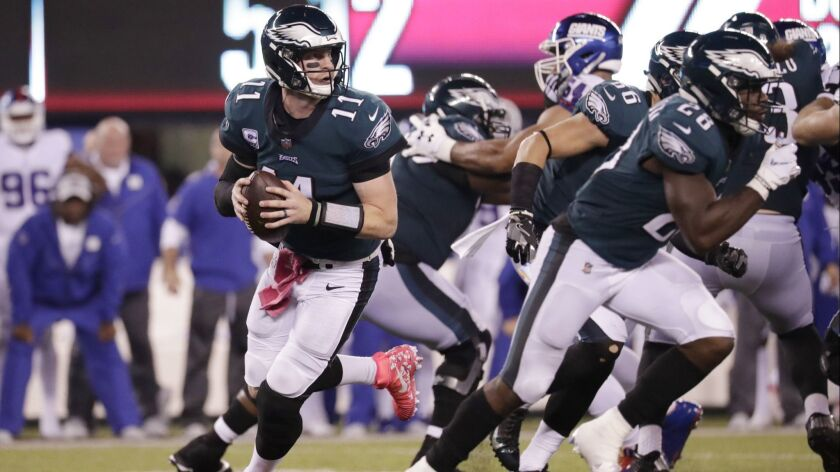 Philadelphia Eagles quarterback Carson Wentz (11) looks to pass during the first half against the New York Giants.