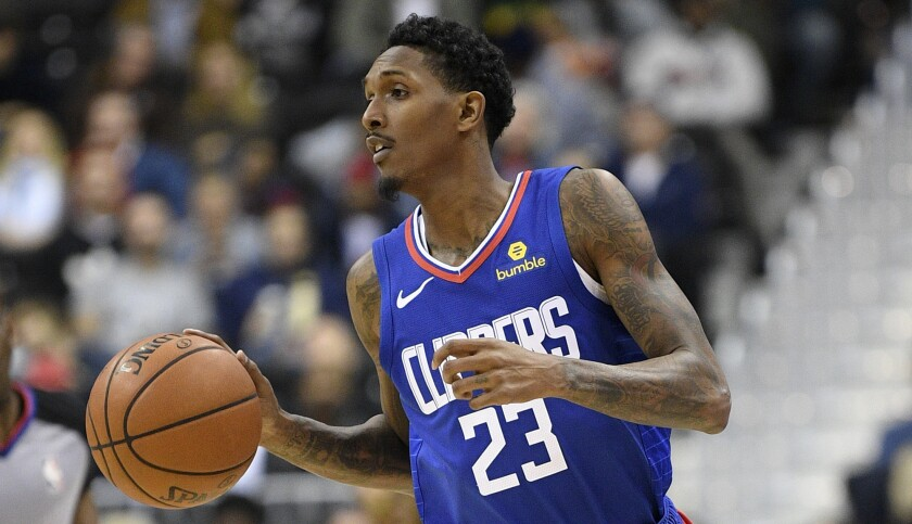 Los Angeles Clippers guard Lou Williams (23) dribbles the ball during the first half of an NBA baske