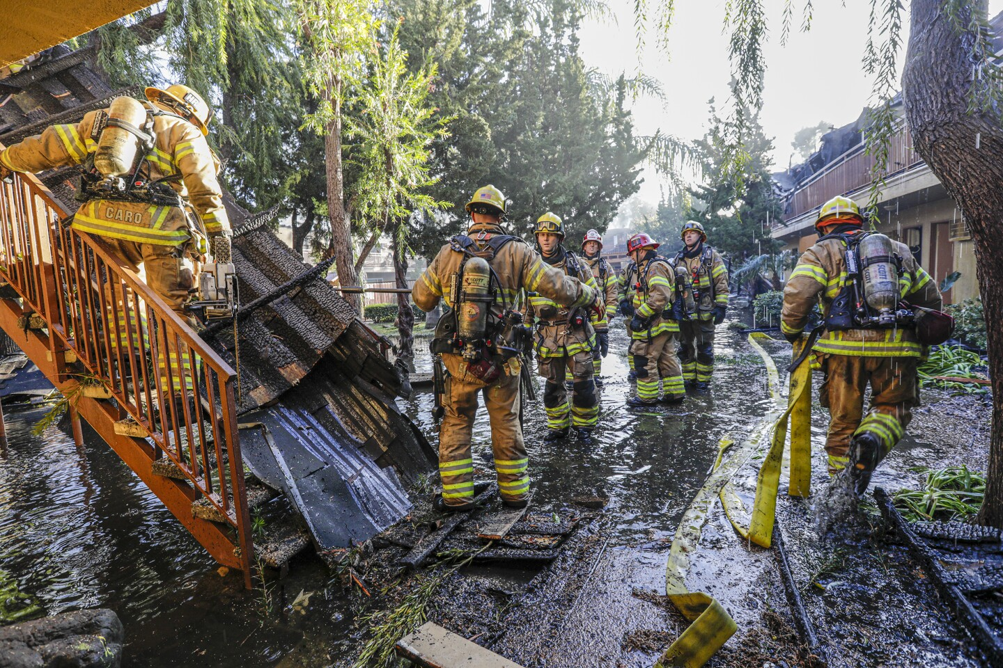 TUSTIN, CA - FEBRUARY 12 , 2020 - A five-alarm fire that caused the roof of a building in a two-story apartment complex in Tustin to collapse today left two residents injured, and firefighters were working to douse hot spots and determine if anyone was unaccounted for. The fire was first reported at 3:01 a.m. at 15751 Williams Street, near McFadden Avenue, according to the Orange County Fire Authority. (Irfan Khan / Los Angeles Times)