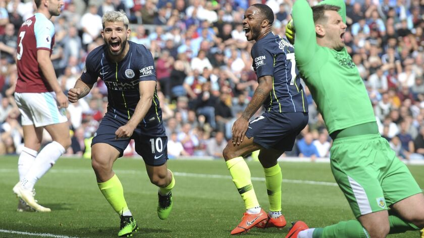 Manchester City's Sergio Aguero, left, celebrates after scoring his side's opening goal during the E