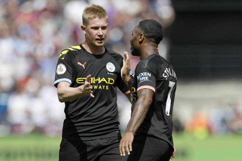 Manchester City's Kevin de Bruyne congratulates Raheem Sterling after a goal against West Ham United on Aug. 10, 2019.