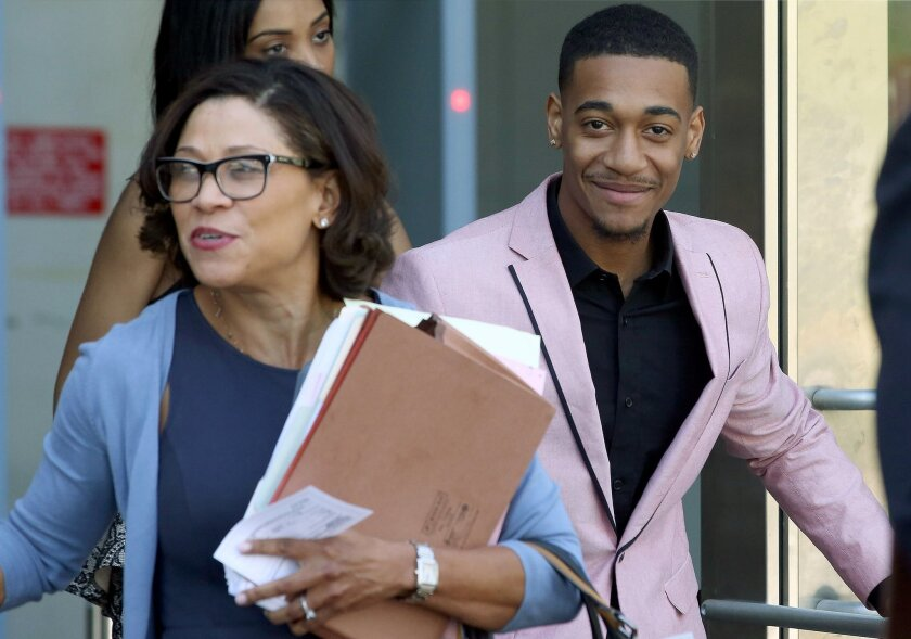 Rapper Lil Za, right, leaves Los Angeles Superior Court with his attorney, Shawn Holley, after his arraignment on Wednesday, April 30, 2014. Lil Za, who's real name Xavier Smith, pleaded no contest to felony possession of ecstasy, and was sentenced to three years of probation and a drug treatment p