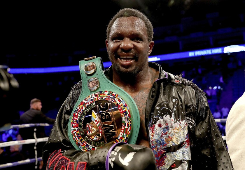 Dillian Whyte celebrates his victory after defeating Oscar Rivas on points in the WBC interim Heavyweight title fight at the O2 Arena, in London, Saturday, July 20, 2019. (Bradley Collyer/PA via AP)