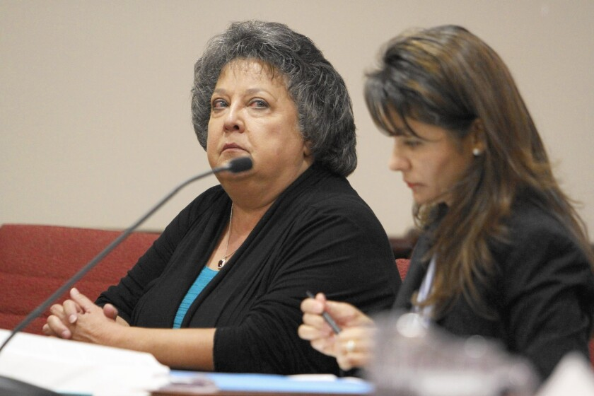 New Mexico Secretary of State Dianna Duran, left, sits in court with her attorney, Erlinda Johnson, in Santa Fe, N.M.