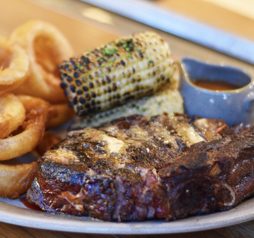 A 34-ounce dry-aged ribeye steak dinner for two at Juniper and Ivy restaurant.