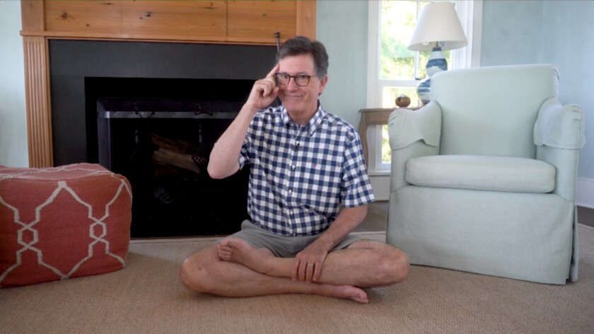 "Stephen Colbert sits at home on his floor, recording an episode of ""The Late Show"""