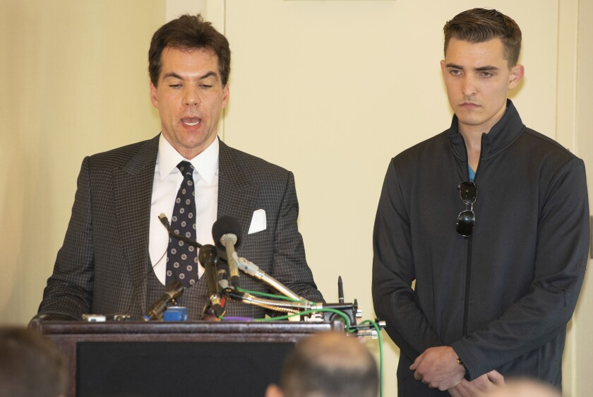 Jacob Wohl, right, and his attorney Jack Burkman