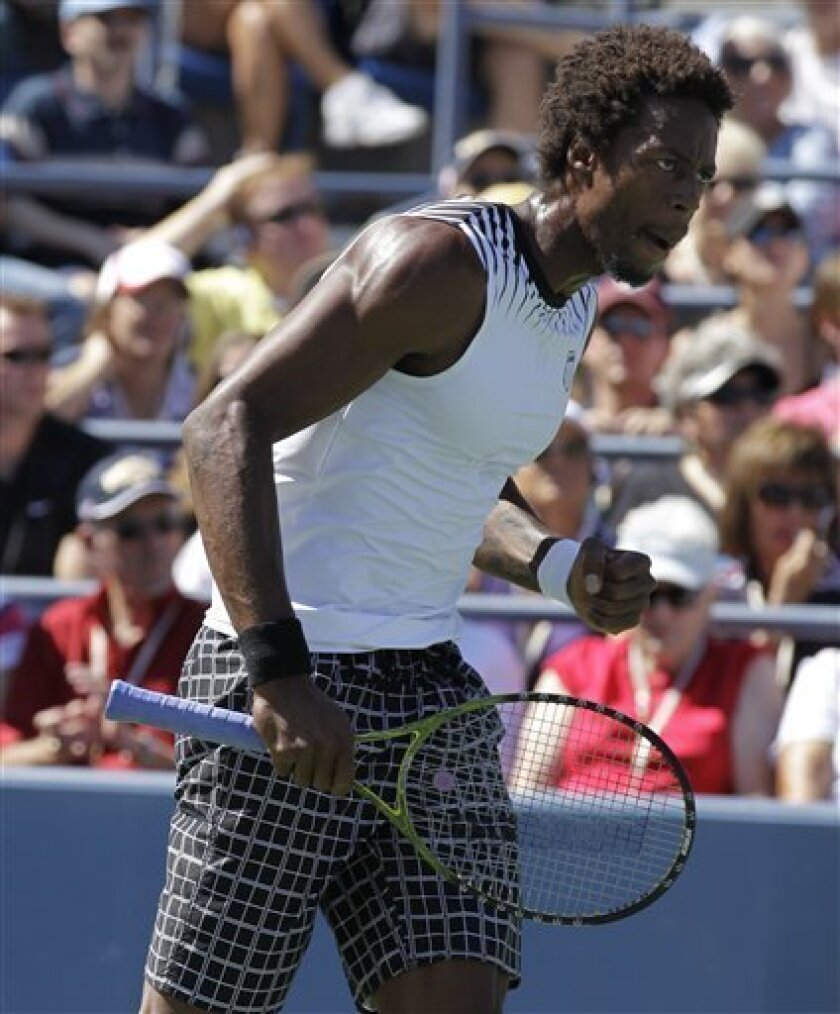 Gael Monfils of France pumps his fist after winning a game against Richard Gasquet of France in the fourth round of play at the U.S. Open tennis tournament in New York, Monday, Sept. 6, 2010. (AP Photo/Darron Cummings)