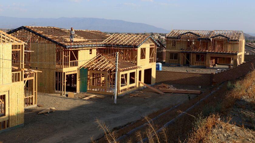 Construction is under way in the Murrieta neighborhood where Josh and Kayleigh Hyink live.