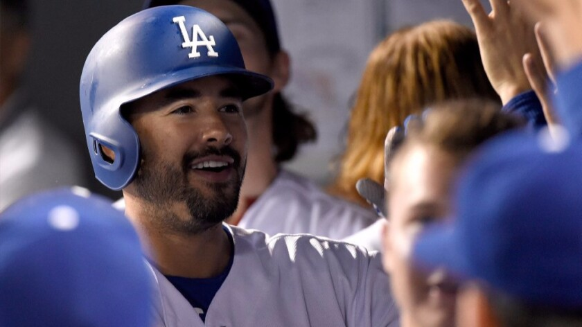 Dodgers outfielder Andre Ethier celebrates in the dugout after hitting a home run against the Rockies during a game on Sept. 23.