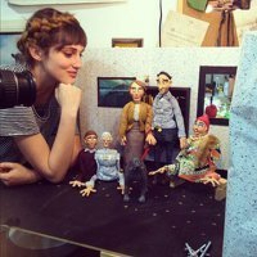 """Jessie Hallstrom with the stop motion animation puppets in her film """"What Goes Up,"""" her senior thesis for School of Visual Arts."""
