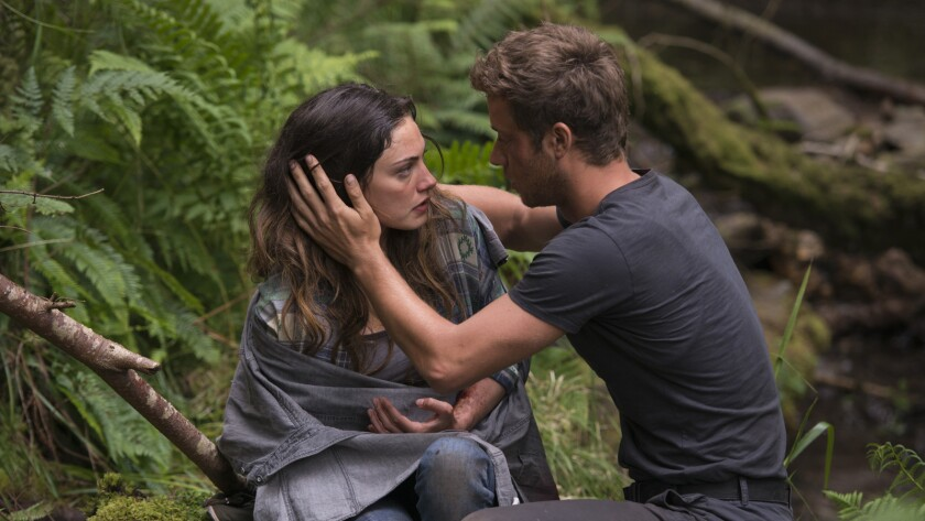 """Phoebe Tonkin and Jeremy Sumpter in the movie """"Billionaire Ransom."""""""