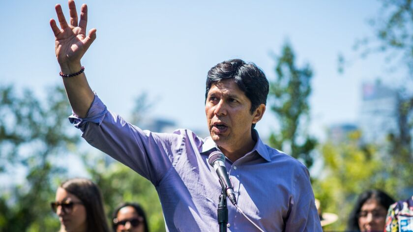 State Sen. Kevin de Leon speaks to a crowd at Vista Hermosa Park in Los Angeles on June 19.