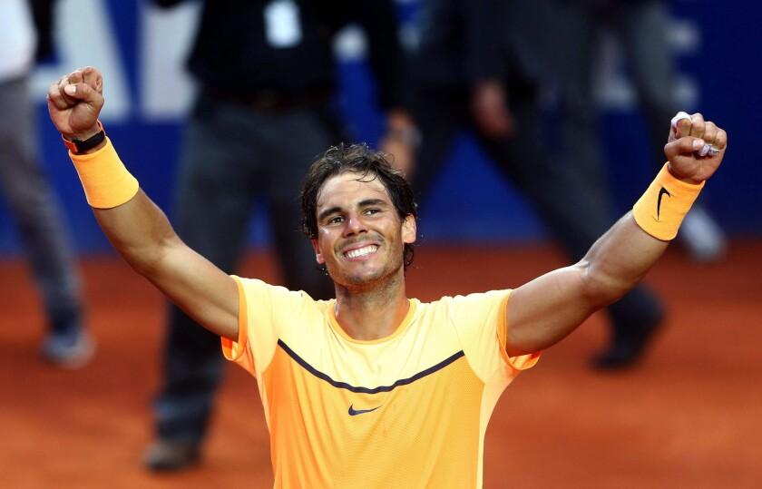Rafael Nadal celebrates his victory over Kei Nishikori in the Barcelona Open championship match on April 24.