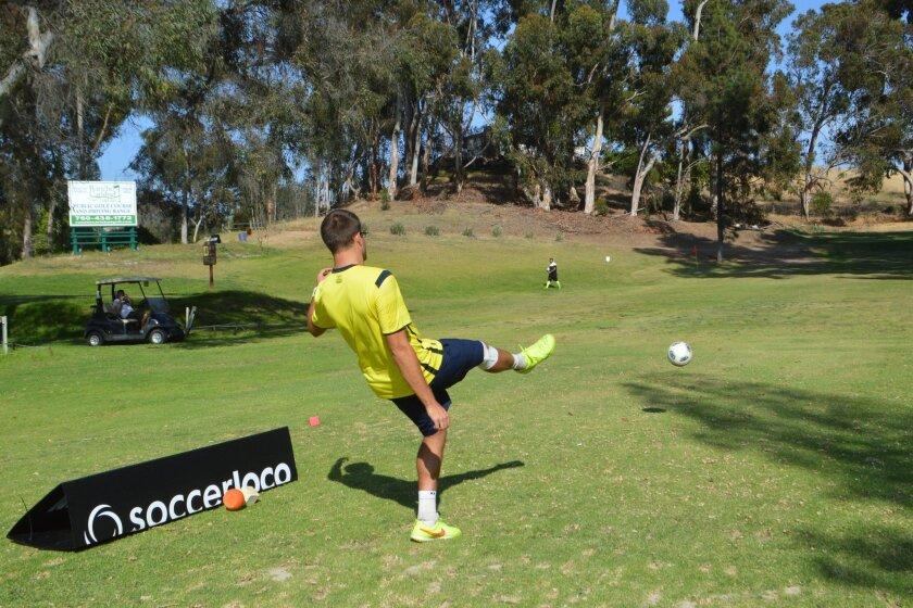 Jordan Godfrey, of La Verne, boots a tee shot on Sunday during FootGolf San Diego's inaugural tournament at Rancho Carlsbad.