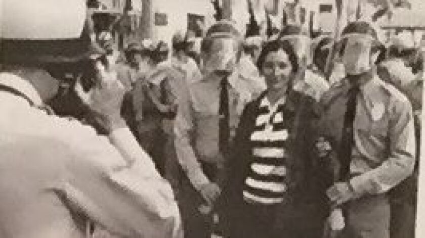 The photo of Linda Blair Forth's arrest was the third picture Fred Lonidier took during the May 4, 1972 protest in front of 11th Naval District offices in San Diego. She was taken to jail, then to a federal court and released later that day.
