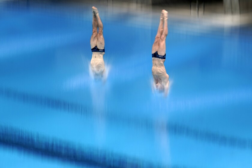 United States' Michael Hixon and Andrew Capobianco perform a dive during the men's synchronized 3-meter springboard preliminaries at the FINA Diving World Cup Sunday, May 2, 2021, at the Tokyo Aquatics Centre in Tokyo. (AP Photo/Eugene Hoshiko)