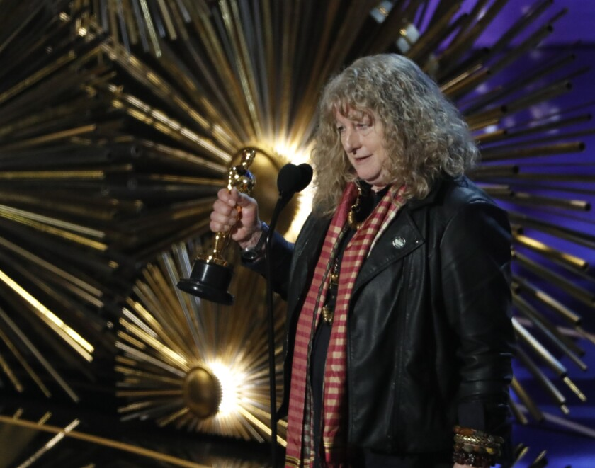 """Jenny Beaven accepts the Oscar for Costume Design, """"Mad Max: Fury Road."""""""