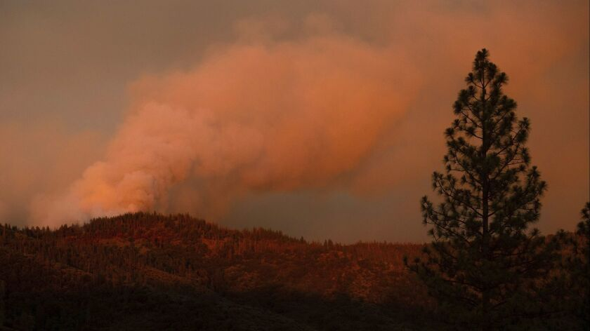 The Ferguson Fire burns along a ridgeline in unincorporated Mariposa County, Calif, on Monday, July