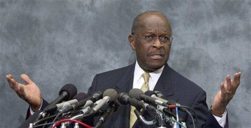 In this Nov. 2, 2011 file photo Republican presidential candidate Herman Cain speaks on Capitol Hill.