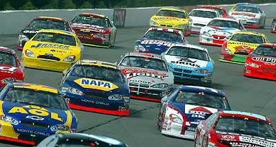The pack heads in to Turn 1 on the beginning lap of the Pennsylvania 500 in Long Pond, Penn.