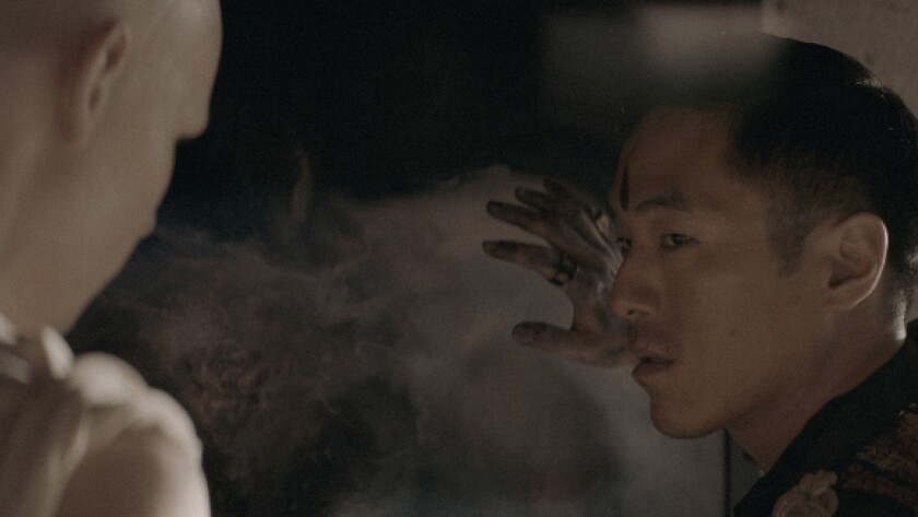 "(L-R)- Garrett Wareing and Leonardo Nam in a scene from the movie ""Perfect."" Credit: Brainfeeder Fi"